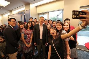 PM Lee spent more than an hour chatting and taking photos with guests at Sunday's reception with Singaporeans held at the Permanent Mission of Singapore to the UN.