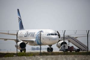 The EgyptAir Airbus A-320 on the tarmac of Larnaca airport after it was hijacked and diverted to Cyprus on March 29, 2016.