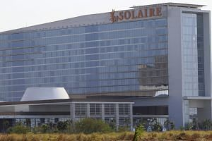 The Solaire Hotel and Casino, which stands in a gaming complex, is seen along Macapagal road in Paranaque city, metro Manila, on March 21, 2016.