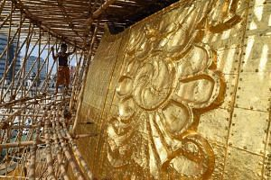 A section of the Sule Pagoda's tower is pictured covered in gold after renovations, on March 12, 2016.