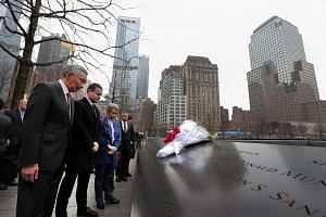 PM Lee and his wife Ho Ching at the National September 11 Memorial & Museum in New York on Monday. The names of the victims of the attack are etched on panels surrounding two pools.