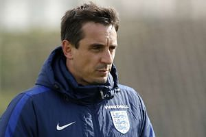 England coach Gary Neville seen at the Tottenham Hotspur Training Ground in Hertfordshire on March 28, 2016.