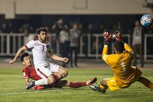 Forward Wu Lei sealing China's 2-0 win against Qatar with his 88th-minute shot past defender Khaled Muftah and goalkeeper Amine Lecomte. Having done their job, the Dragons went through to the next round after an amazing series of results across the contin