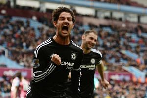 Chelsea's Brazilian striker Alexandre Pato celebrates after scoring from the penalty spot.