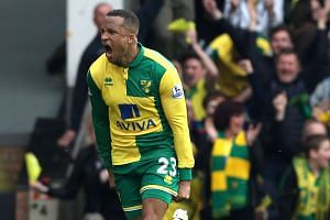 Norwich City's Swedish defender Martin Olsson celebrates after scoring to make it 3-2.