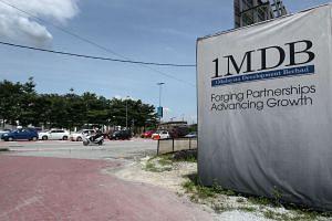 A sign for 1Malaysia Development Bhd. (1MDB) is displayed at the site of the Tun Razak Exchange (TRX) project in Kuala Lumpur, Malaysia.