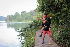 Mr Lin, a Bone Marrow Donor Programme ambassador, carrying Mr Ng, his hiking partner. They are aiming to complete the 1,000km route across the Bibbulmun Track in Australia in 20 days to raise awareness for the programme.