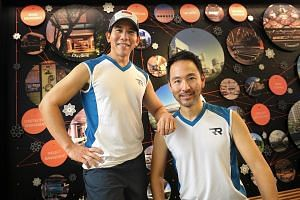 Mr Ong Tze Boon (right) and Ong Yu-Phing have raised $200,000 for five charities that support the mentally ill. They have completed seven marathons in seven continents over seven consecutive days.