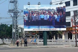 A billboard highlighting President Xi's visit to Tanmen at one of the town entrances. His visit coincided with a development boom in the once-sleepy village. Giant clam handicraft products on display. A speciality of Tanmen, they are also the village