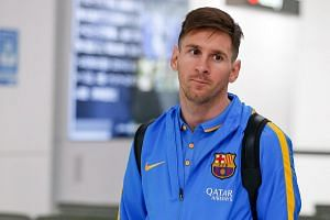 Barcelona player Lionel Messi arriving at Narita International Airport on Dec 14, 2015.