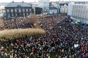 Protesters in Reykjavik, Iceland, on Monday demanding the resignation of Prime Minister Sigmundur David Gunnlaugsson, one of those allegedly linked to secret offshore companies. Mr Gunnlaugsson resigned yesterday.