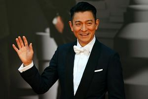 Andy Lau poses for a photograph on the red carpet at the Hong Kong Film Awards on April 3, 2016.