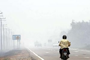 Bush fires causing severe haze in Bongawan near Papar in Sabah.