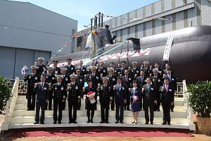 Guests including South Korea's chief of naval operations posing in front of the new submarine Hong Beom Do at its launch ceremony on Tuesday at the Hyundai Heavy Industries dockyard in the south-eastern city of Ulsan. The 1,800-tonne, diesel-electric