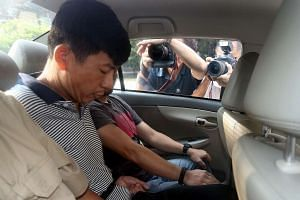Malaysian Boh Soon Ho, 47, arriving at the State Courts in an unmarked car.