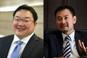 Malaysian businessman Low Taek Jho (left) and state investor's first managing director and CEO Shahrol Azral Ibrahim Halmi.
