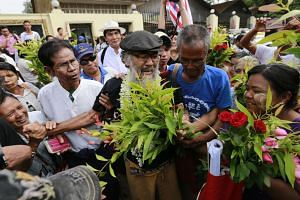 Mr Thet Wai, 61, who was detained for his illegal solo protest, is welcomed by activists as he leaves the Insein prison in Yangon, Myanmar, on April 8, 2016. Reports state over 4000 prisoners across the country including some political prisoners are