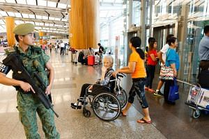 Military Security officer on patrol at Changi Airport Terminal 2 on March 23, 2016.