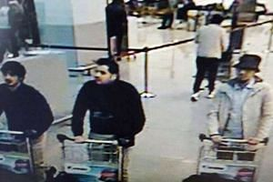 """Mohamed Abrini has admitted to being the """"man in the hat"""" (right) at Brussels airport."""