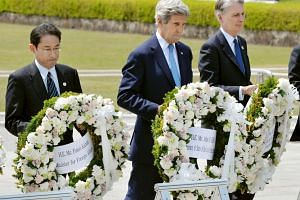 US Secretary of State John Kerry (centre) preparing to lay a wreath at the cenotaph with Japan's Foreign Minister Fumio Kishida (left), Britain's Foreign Minister Philip Hammond and other G-7 foreign ministers at Hiroshima Peace Memorial Park and Mus