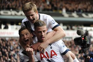 Toby Alderweireld (centre) of Tottenham Hotspur celebrates with his team mates after scoring a goal against Manchester United on Sunday.