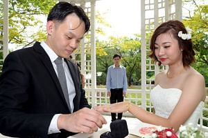 A photograph of Ms Jaclyn Ying and Mr Kelvin Tang on their wedding day.