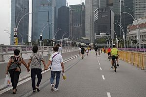Strollers and cyclists taking advantage of car-free Sunday in the CBD last month. Transport Minister Khaw Boon Wan yesterday said that learning to drive and owning a car might be a thing of the past, and Singapore needed to prepare for such a future