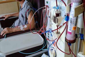 A diabetic patient undergoing dialysis treatment at Kim Keat Dialysis Centre.
