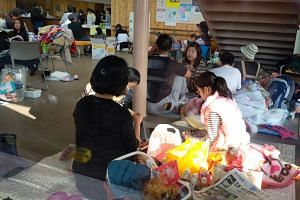 Evacuees gather at a health center in Mashiki, Kumamoto prefecture on April 15, 2016.