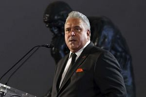 Embattled tycoon Vijay Mallya's diplomatic passport has been suspended by India for four weeks.