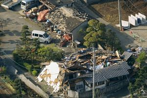 Collapsed houses caused by an earthquake in Mashiki town, Kumamoto prefecture, southern Japan on April 15, 2016.