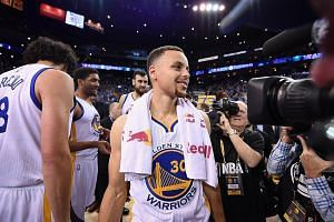 Having guided his team to a historic 73-9 record, Stephen Curry of the Golden State Warriors shows his relief after the 125-104 victory against the Memphis Grizzlies at Oracle Arena on Wednesday.