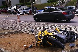 Actress Rui En (left) hit Mr Bahrom Sarmiten's motorcycle with her BMW on Tuesday. He rejected her offer of $2,000 compensation as he said it would not cover the cost of repairs to his bike.