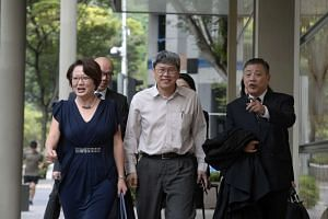 Workers' Party MPs Sylvia Lim (left) and Png Eng Huat (centre) with lawyer Peter Low arriving at the Supreme Court on Jan 22, 2016.