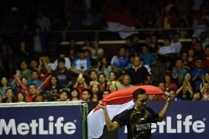 Sony Dwi Kuncoro of Indonesia celebrates his win against Son Wan Ho of South Korea during the men's singles final at the Singapore Open on April 17, 2016.