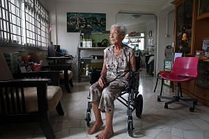 Madam Khoo, who now uses a wheelchair, has turned down offers of a prosthetic hand and says it should instead be given to younger people in her situation.