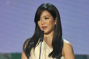 Actress Rui En speaking after receiving her All Time Favourite Artiste Award yesterday. The TV star has been in the news after she knocked down a parked motorcycle in Clementi last Tuesday. During her speech, she asked for forgiveness and said her st