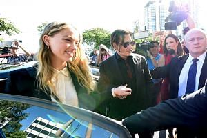 Actor Johnny Depp and wife Amber Heard arrive at the Southport Magistrates Court on Australia's Gold Coast.