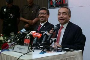 CIMB Group Chairman Nazir Razak (right) and CEO Zafrul Aziz.