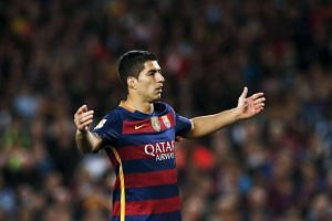 Barcelona's Luis Suarez gestures against Valencia during Sunday's loss.