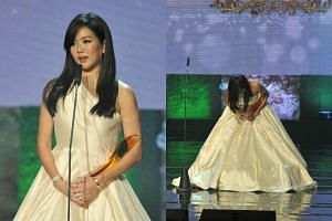 Actress Rui En speaking after receiving her All Time Favourite Artiste Award yesterday. At the end of her speech, she moved away from the microphone and gave a deep bow.