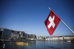 Swiss officials have suspended the citizenship process of two Muslim brothers who refused to shake their female teachers' hands for religious reasons.