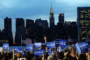 Democratic Presidential candidate Bernie Sanders speaks at a campaign rally on April 18 with the skyline of New York behind him.