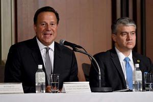 Panamanian President Juan Carlos Varela (left) delivers his speech at the Panama investment seminar in Tokyo, on April 19, 2016.