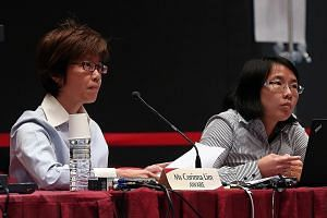 Aware representatives Corinna Lim (left) and Jolene Tan at the hearing yesterday. Ms Lim proposed that those who run organisations with a net asset value of $50 million be considered so more can stand for election.
