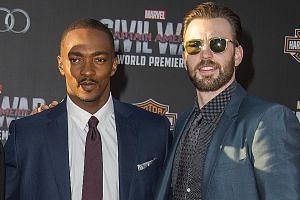 Captain America stars Anthony Mackie (above left) and Chris Evans are scheduled to walk the blue carpet for the movie in Singapore tomorrow.