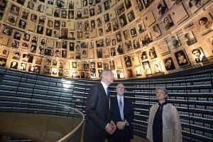 PM Lee and Mrs Lee with Dr Robert Rozett, Yad Vashem Libraries director, inside the Hall of Names at the memorial for victims of the Holocaust, in Jerusalem yesterday.