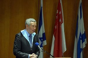 Prime Minister Lee Hsien Loong speaking at the Hebrew University on Monday, after an honorary doctorate was conferred on him.