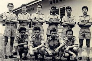 Mr Mohamed Haniffa (standing, fourth from the left) and Mr Derek Yeo (standing, second from the left) at RAF Training Centre in RAF Seletar, with their Aero Engine course mates. This photo was taken in August 1965.