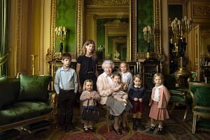 This handout portrait picture taken by US photographer Annie Liebovitz shows Queen Elizabeth II (centre) posing with her two grandchildren, James, Viscount Severn (left) and Lady Louise (second left) and her five great-grandchildren Mia Tindall (hold